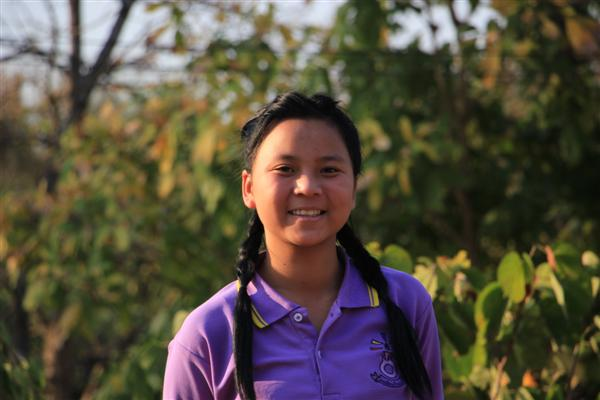 Volunteers say Joy has excellent English language skills. She is always willing to help her classmates and often translates for volunteers.