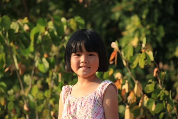 Volunteers say Ying is a sweet girl with an even sweeter smile! She loves hugs and sitting down to watch all the other kids play.