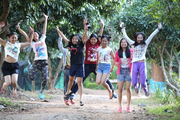 Girls from Warm Heart cheering and jumping
